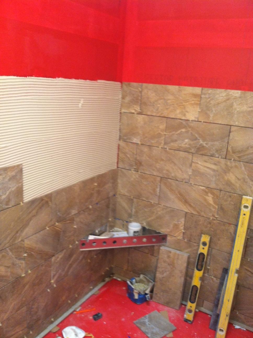 Waterproofing bathroom tile - Wall Tile Is Being Installed